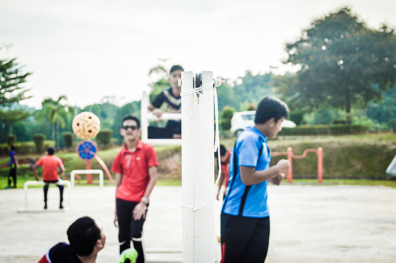 Takraw 2. Leisure Activity Lifestyles Adult Fun Togetherness Men Playing Boys Outdoors People Standing Day Males  Motion Spraying Soccer Real People Sport Child Only Men EyeEm Selects EyeEmNewHere The Week On EyeEm Portrait EyeEmSelect