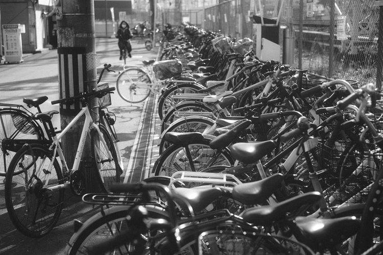 Bicycles parked on street in city