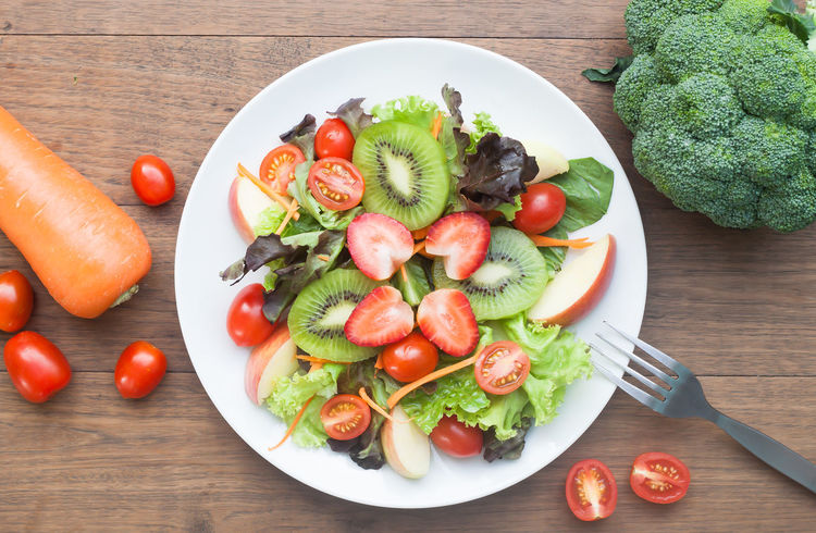 Top view of fresh salad with strawberries and kiwi on top Cherry Tomato Flat Lay Food Food And Drink Fresh Freshness Fruit Fruits Health Healthy Eating Indoors  Kiwi - Fruit No People Plate Ready-to-eat Salad Salad Still Life Strawberries Table Tomato Top View Vegetable Vegetables