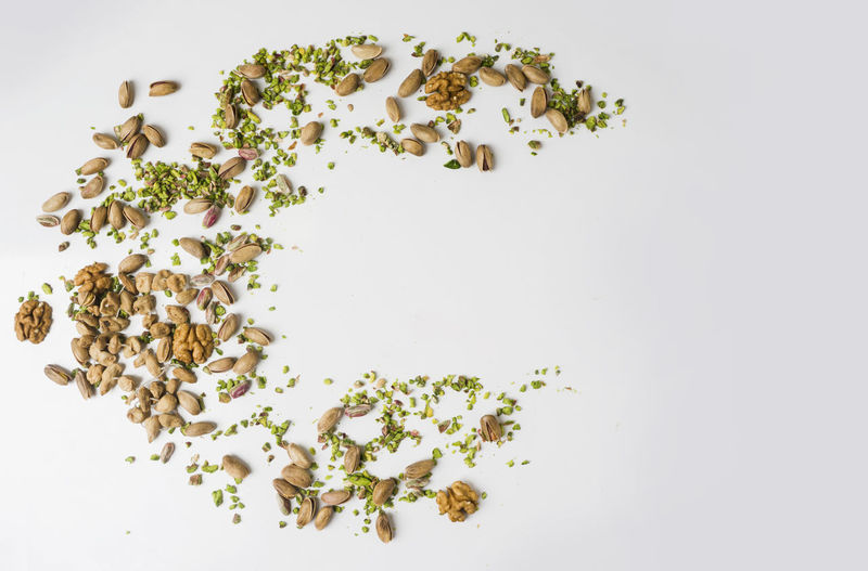 Healthy mixed nuts on wooden background .peanuts, walnuts Grains Close-up Composition Composition Food Leaf Mingle As Food No People Peanut Snacking On Pineapple Chips Snacking On This During Nsl Exam .  Snacks Studio Shot Walnuts White White Background