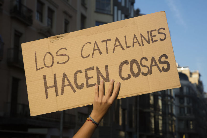 """Barcelona, Spain - October 3, 2017. Demonstrators bearing placards during protests for independence in Barcelona, Catalonia, Spain. On that banner is said: """"Catalans do things (referring to an statement said by president of Spain Mariano Rajoy)"""" Barcelona Catalonia Catalonia Is Not Spain Democracy Freedom Independence Independencia Politics Protest Protest Signs Protests Rights Challenge Crowd Democratic Independent  March Political Politics And Government Protesters Protesting Protestor Protestors Riot Riots"""