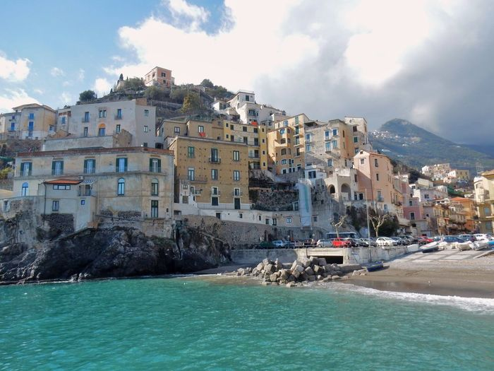 Water Sea Building Exterior Sky Architecture Built Structure Building Nature Waterfront City Cloud - Sky Day Land Mountain Transportation Residential District Beauty In Nature Beach Rock Outdoors No People Amalfi Coast