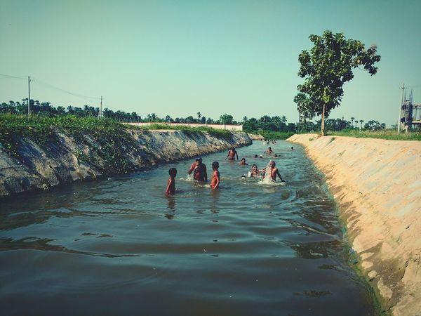 Live For The Story Boys Having Fun Fun In The River Fun In The Sun Kids Playing Summer Summertime Summer Views Summer Memories 🌄 Summer Atmosphere Bath In The River Sun Bath Village Scene Landscape River Water Nature Village View Village Photography Village Life Reflection Lifestyles Sun Adult People