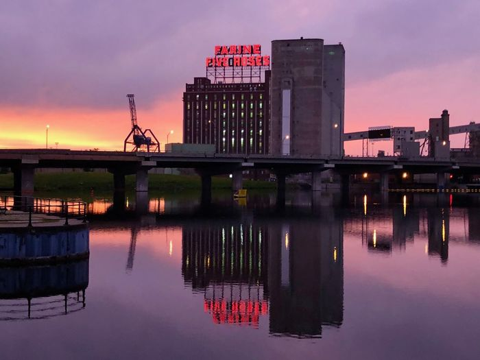 Sunrise Purple Farine Bakery Farine Five Roses Architecture Built Structure Sky Water Reflection Sunset Building Exterior Waterfront Nature River Bridge Cloud - Sky No People Connection Illuminated Bridge - Man Made Structure Industry