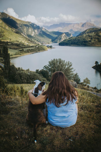 EyeEm EyeEm Best Shots EyeEm Selects EyeEm Gallery Beauty In Nature Brown Hair Day Hair Hairstyle Lake Leisure Activity Looking At View Mountain Mountain Range Nature Non-urban Scene One Person Outdoors Rear View Scenics - Nature Sitting Tranquil Scene Tranquility Water Women