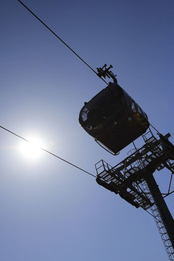 Silhouette overhead cable car with blue sky background in Korea Sky Low Angle View Clear Sky Crane - Construction Machinery Machinery Nature Sun No People Outdoors Sunlight Day Construction Industry Blue Cable Silhouette Architecture Lighting Equipment Built Structure Metal Tall - High Construction Equipment Silhouette