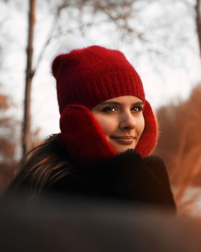Portrait of smiling young woman in snow
