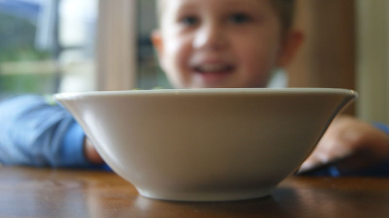 One Person Headshot People Drink Indoors  Food And Drink Table Bowl Sitting Day Close-up Little Boy Child Childhood Breakfast Time Happiness Smiling Portrait Human Body Part Cheerful Adult Human Hand Child Smiling Breakfast Bowl Ceramic Bowl Place Of Heart