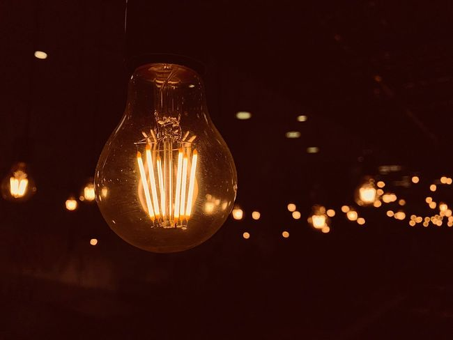 Light bulb Illuminated Lighting Equipment Light Bulb Glass - Material No People Electricity  Close-up Glowing Filament Light Light - Natural Phenomenon Night Focus On Foreground Indoors  Bulb Orange Color Electric Light Transparent Hanging Sky