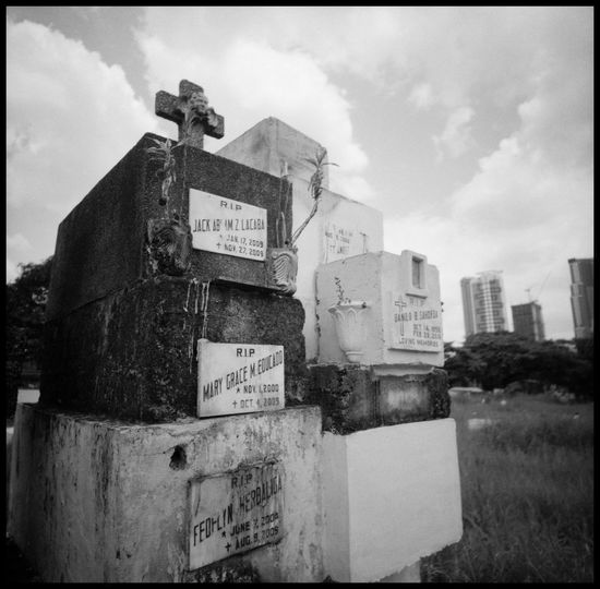 The South Cemetery of Manila Analogue Photography Architecture Cemetery Christian Graves Concrete Graves Construction Filipino Graveyard Grave Boxes Graves In The City Lomography Manila Manila Cemetery Philippines South Cemetery Travel Adventure Black And White Dead People Graves Graveyard Makati Metropolis Necropolis Outdoors