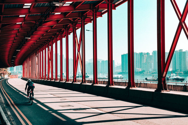 Architecture of Hong Kong. Architecture Bridge Bridge - Man Made Structure Building Exterior Built Structure City Day Full Length Lifestyles Men Modern Nature One Person Outdoors Real People Shadow Sunlight Transportation Travel Walking Water