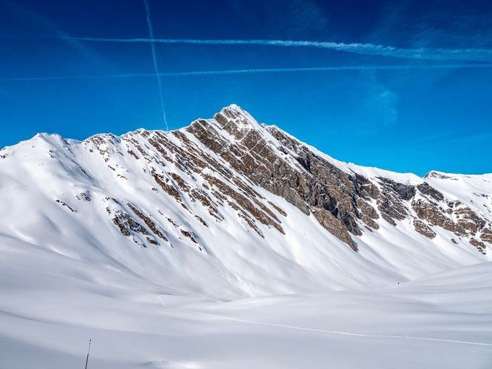EyeEm Selects Snow Winter Cold Temperature Mountain Winter Sport Sky Beauty In Nature Snowcapped Mountain Sport Scenics - Nature Landscape Environment Tranquil Scene Mountain Range Day Ski Slope Non-urban Scene Nature Skiing Blue