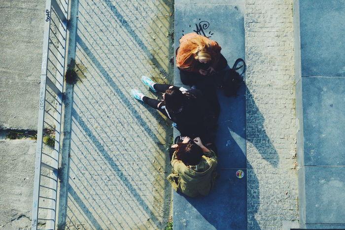 Enjoying the Spring Sun Urban Spring Fever Urban Urbanphotography Urban Lifestyle Enjoying Life Enjoying The Sun City City Life TheWeekOnEyeEM Eye4photography  EyeEm Gallery Street Streetphotography City Streets  Walking Around Taking Photos From My Point Of View Directly Above People Girls Youth The Street Photographer - 2016 EyeEm Awards Girl Power