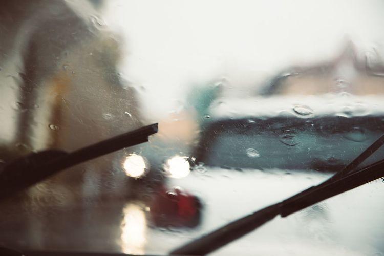 17.62° Glass - Material Car Mode Of Transportation Motor Vehicle Window Wet Transparent Transportation No People Rain Indoors  Water Drop Land Vehicle Vehicle Interior Close-up Windshield Nature Rainy Season RainDrop Glass Garage