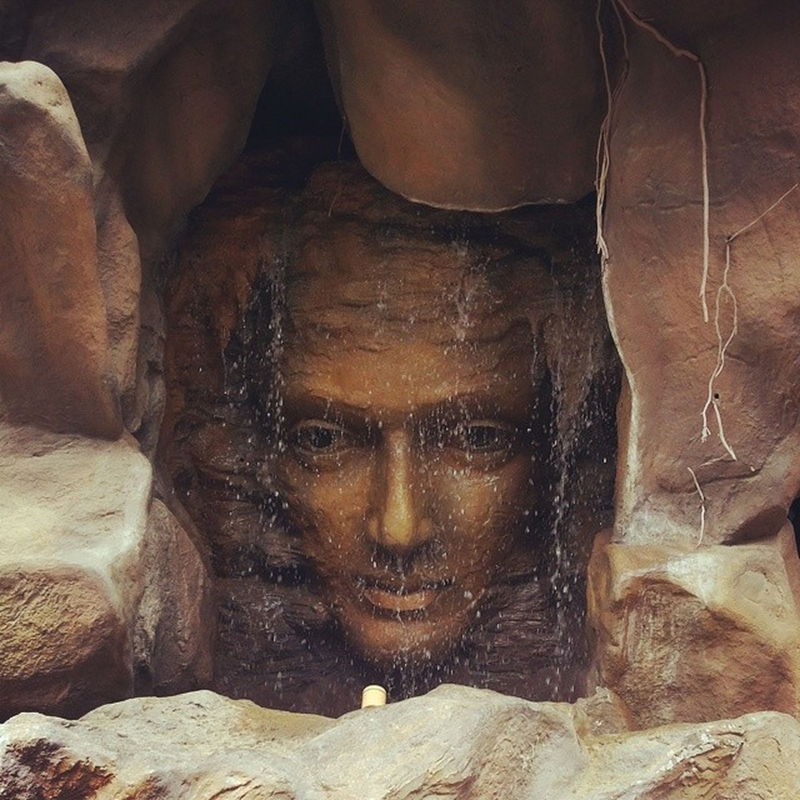 art, creativity, art and craft, young adult, close-up, human representation, indoors, lifestyles, front view, wall - building feature, statue, human face, leisure activity, cave, day, rock - object, sculpture