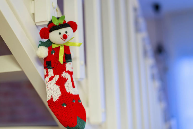 Red Christmas socks on wooden stairs decoration. Celebration Red Decoration Holiday Close-up No People Hanging Representation Art And Craft Focus On Foreground Creativity Indoors  Human Representation Christmas White Color Day Event Selective Focus