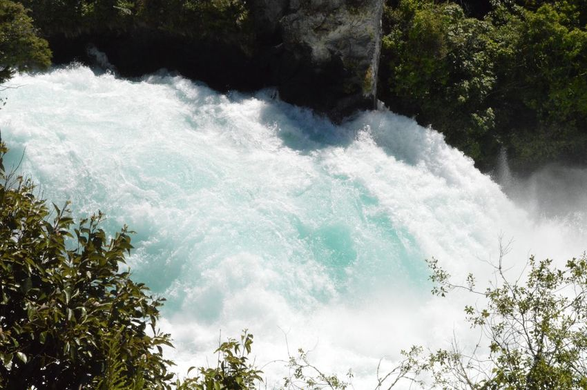 Huka Falls Taupo New Zealand Huka Falls Beauty In Nature Nature Tree Water Motion Flowing Water Scenics Outdoors Waterfall Day Forest No People Tranquil Scene Growth Plant Power In Nature Tranquility Wave Sky