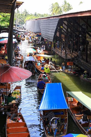 the hustle bustle at the floating market Architecture Building Exterior Day Floating Market Dumnoen Saduak Food Vendors Large Group Of People Market Men Outdoors People Real People Retail  River Transportation Women Wooden Boats