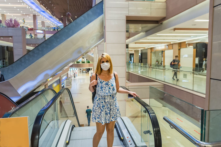 Woman walking in shopping mall