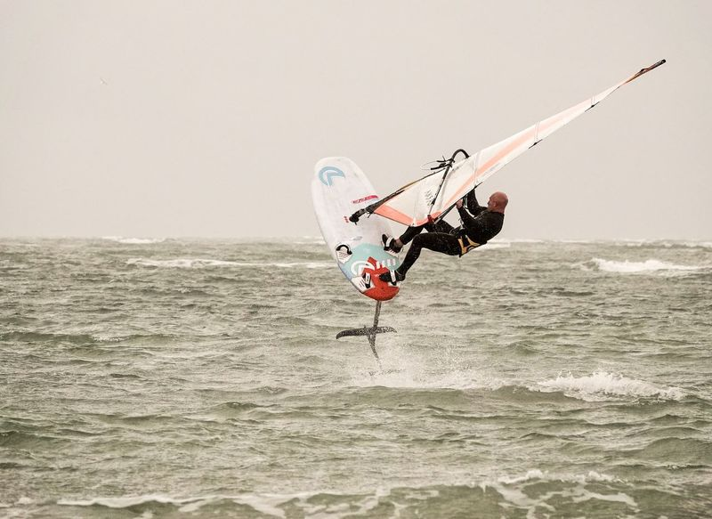 A windsurfer testing a new hydrofoil board off Hayling Island in Hampshire, UK. Jamesjagger Watersports Hayling Island  Windfoiling Windfoil Hydrofoiling Hydrofoil Hydrofoil Windsurfing Windsurfer Water Sea One Person Nature Real People Waterfront Men Extreme Sports Sport Leisure Activity