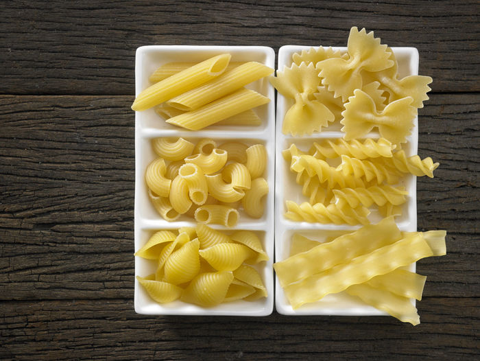 Close-up of colorful fusilli pasta in container on table