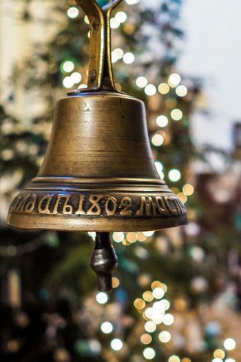 Bell Christmas Bell Postcard Bell Blured Background Christmas Christmas Decoration Close-up Day Focus On Foreground Gold Colored No People Outdoors Tree