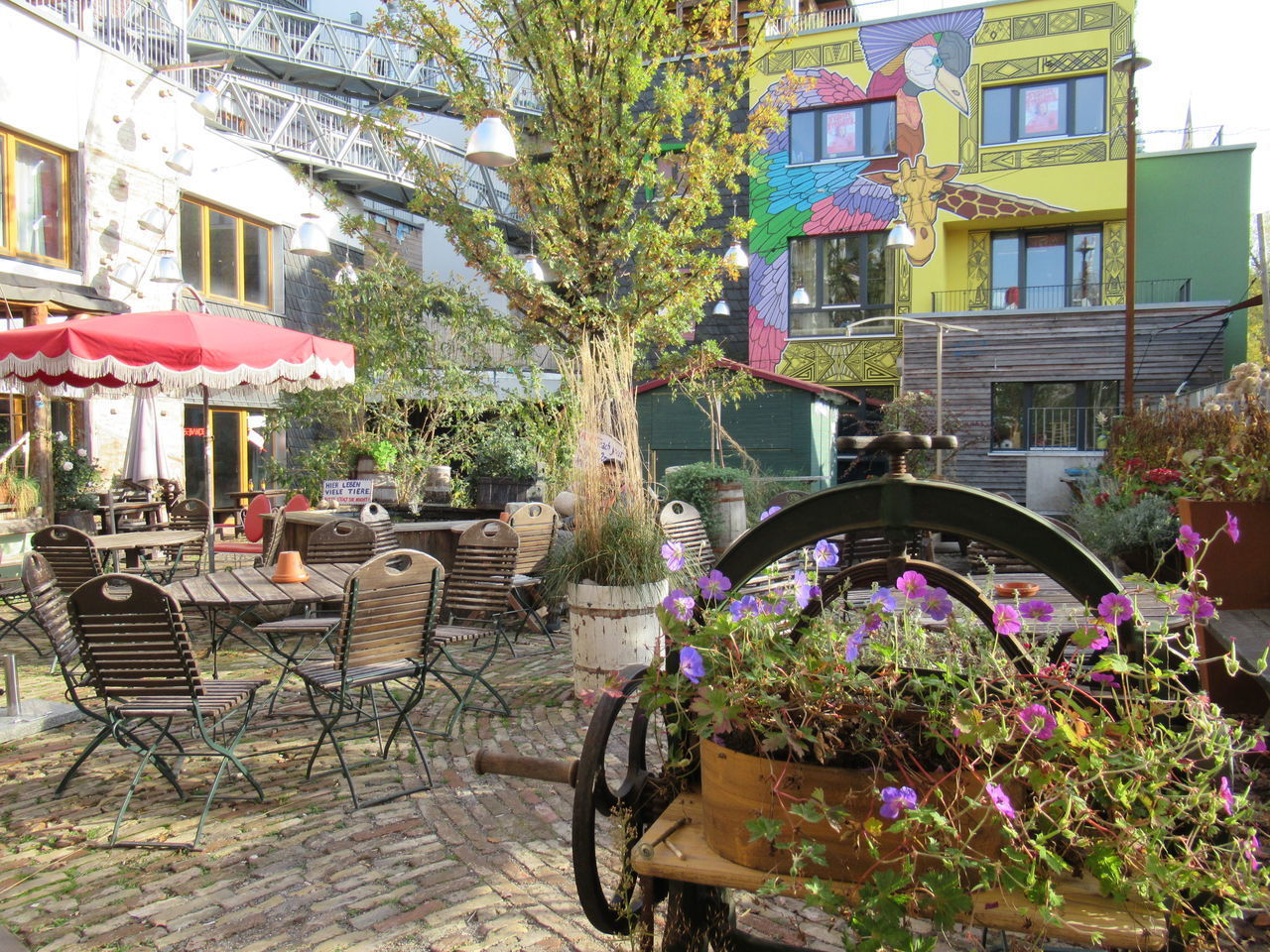 CHAIRS AND TABLES AT SIDEWALK CAFE BY BUILDINGS
