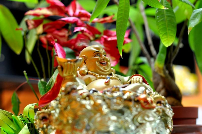 Close-Up Of Laughing Buddha Figurine