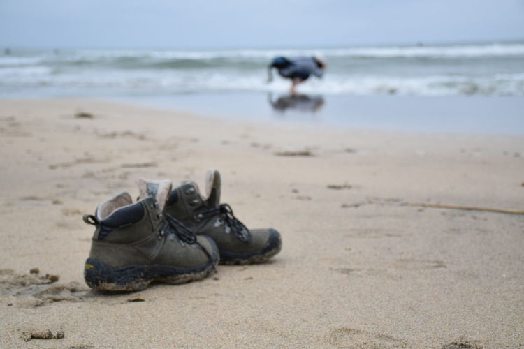 Shoes at sandy beach