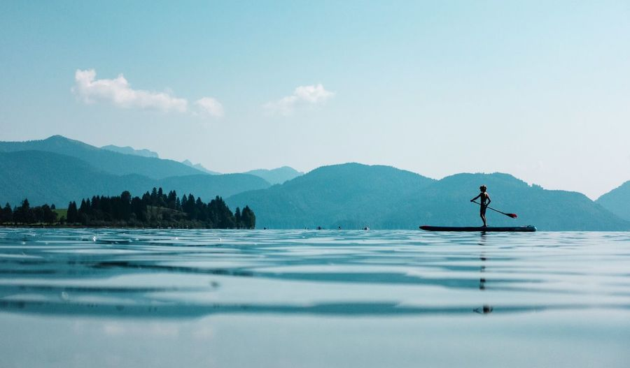 standing... Stand Up Paddling Water Mountain Beauty In Nature Scenics - Nature Tranquil Scene One Person Tranquility Lake Nature Sky Day Mountain Range Waterfront Non-urban Scene Real People Tree Idyllic Outdoors