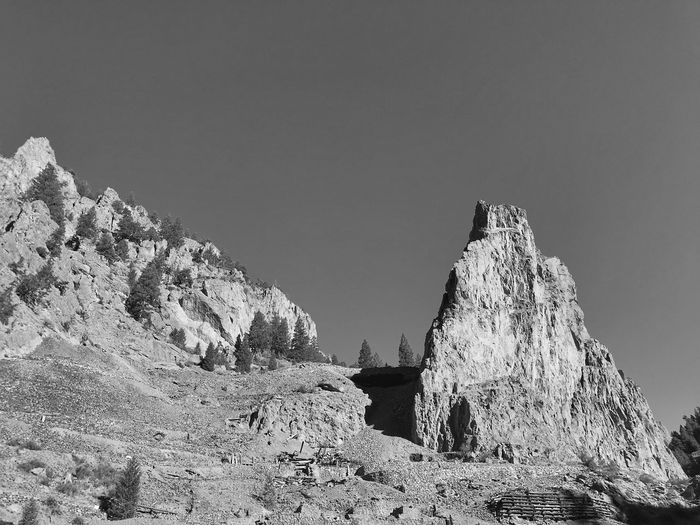 Low angle black and white landscape of large pointed rocks on a hill in Colorado Colorado Black And White EyeEm Selects Sky Nature Low Angle View Day No People Clear Sky Copy Space Beauty In Nature Mountain Outdoors Tranquility Sunlight Growth Rock Rock - Object