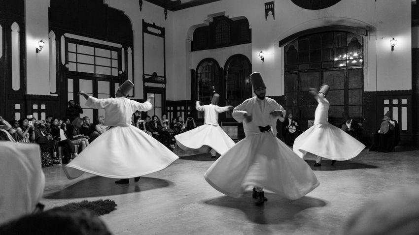 Semze Dancing Indoors  Istanbul Mevlana Semazenler Side View Sitting Turkey