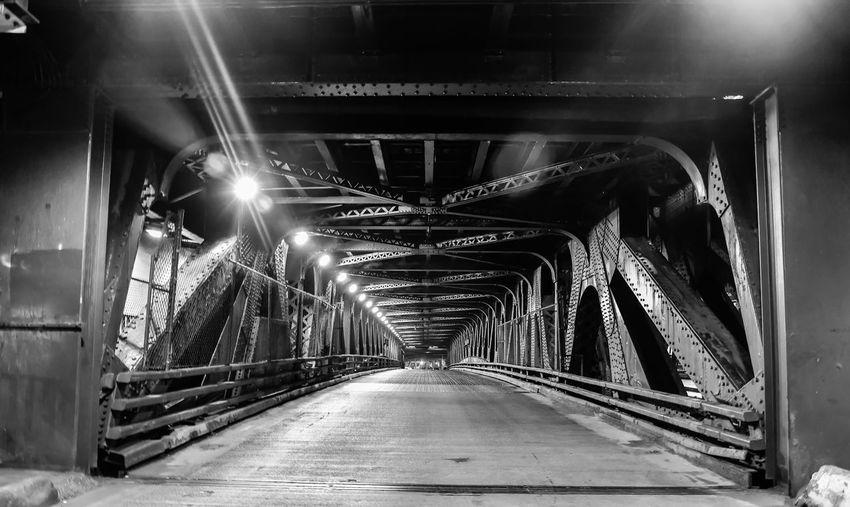 Bridge in illuminated tunnel