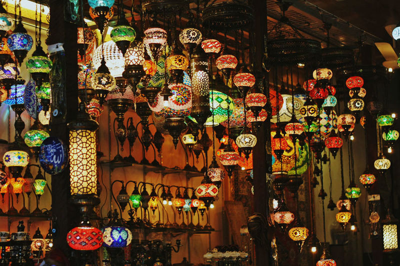 Multi colored lanterns for sale in shop