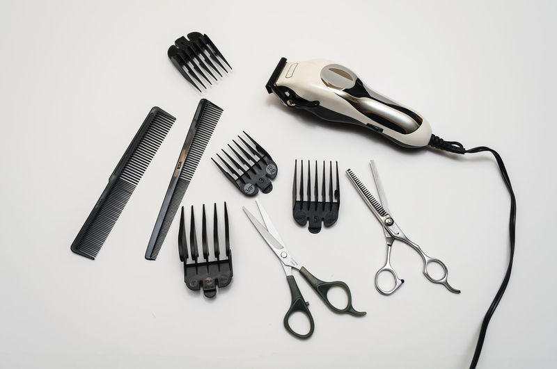 Hairdresser's tools on white background