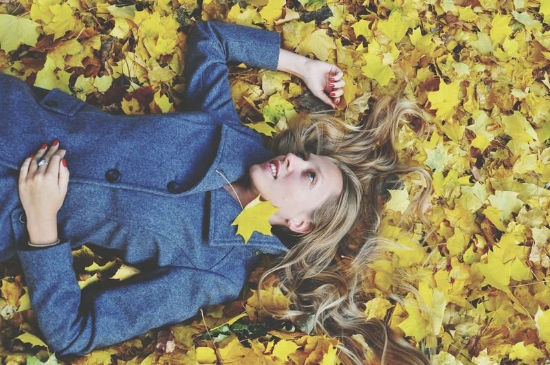 Blonde woman in yellow maple leaves Lying Down Lying On Back High Angle View Yellow Relaxation Autumn Happiness Enjoyment Beautiful Woman Long Hair Mix Yourself A Good Time Autumn Fall The Week On EyeEm