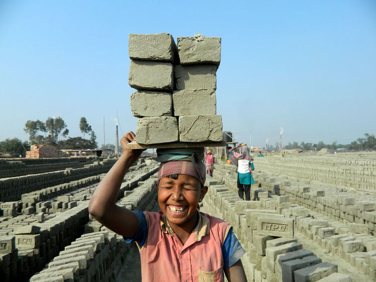 Brick Brick Field Child Worker Girl Hapiness Hard Life Portrait Portrait Of A Woman Smile Smiling Everyday Emotion