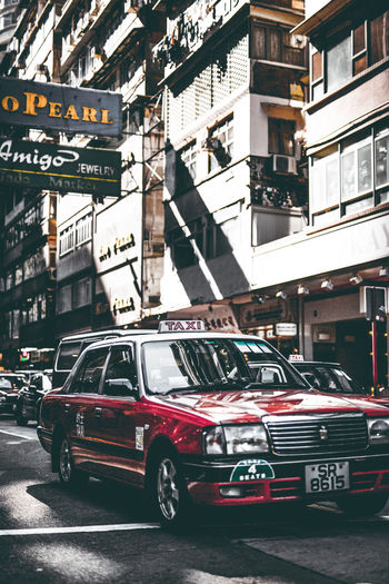 HongKong Architecture Building Building Exterior Built Structure Car City City Life Day Land Vehicle Mode Of Transportation Motion Motor Vehicle No People Outdoors Red Road Street Taxi Transportation