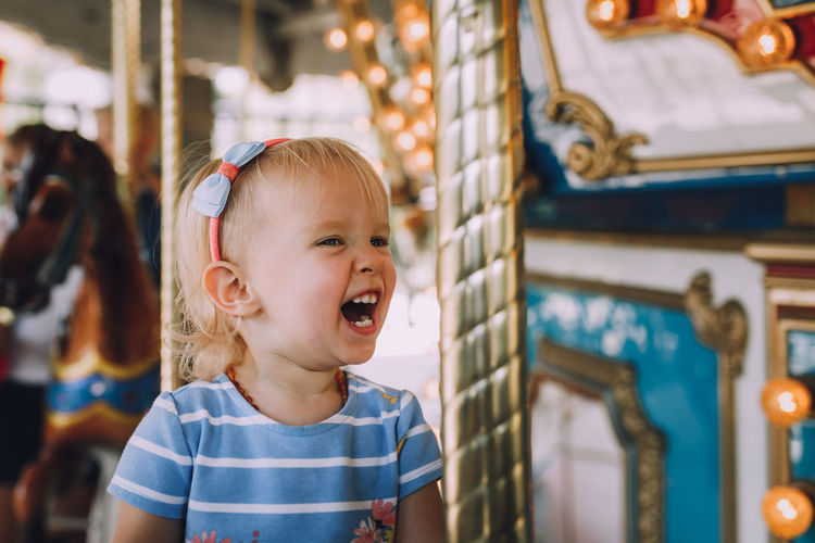 Children Happiness Happy Joyful Amusement Park Amusement Park Ride Blond Hair Carousel Child Childhood Close-up Day Enjoyment Focus On Foreground Girls Innocence Joy One Person Real People Toddler  Fresh On Market 2017