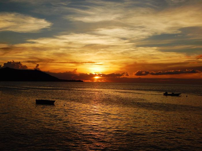 Sunset Water Sea Scenics Sky Nature Beauty In Nature Tranquil Scene Silhouette Tranquility Cloud - Sky Sun Outdoors No People Travel Destinations Horizon Over Water Beach Nautical Vessel Day