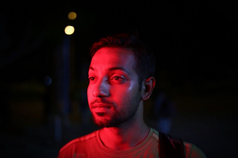 Red Headshot Portrait One Person Young Adult Front View Lifestyles Red Real People Young Men Illuminated Night Focus On Foreground Teenager Teenage Boys Close-up