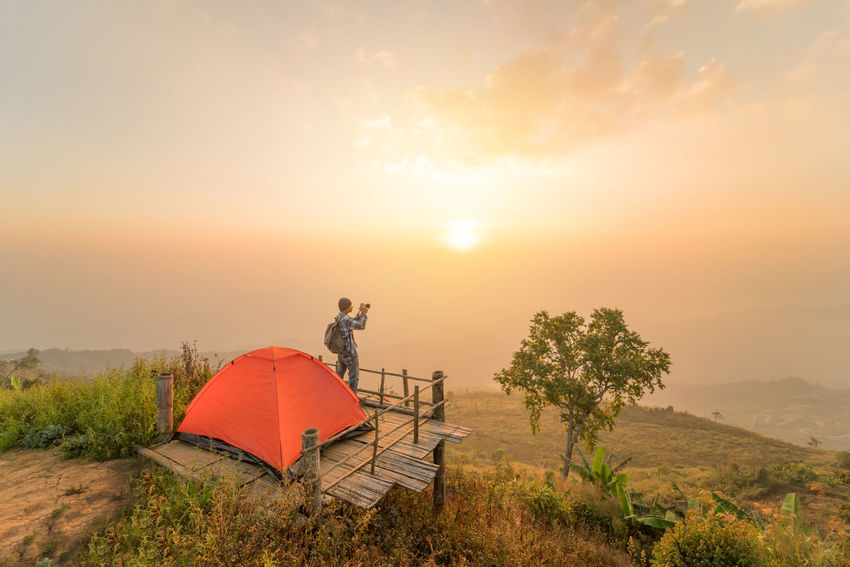 camping tent on the hill with sunrise or sunset background Camera Hiking Adventure Backpack Beauty In Nature Camping Area Cliff Cloud - Sky Environment Extream Landscape Mountain Nature Outdoors Photographer Scenics - Nature Sky Sun Sunset Tent