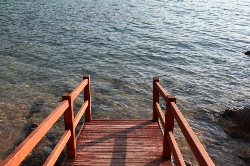 Bodrum Travelphotography Steg Water Wood - Material Railing High Angle View Staircase Tranquility Nature Beauty In Nature Tranquil Scene Sea Pier Sunlight Outdoors