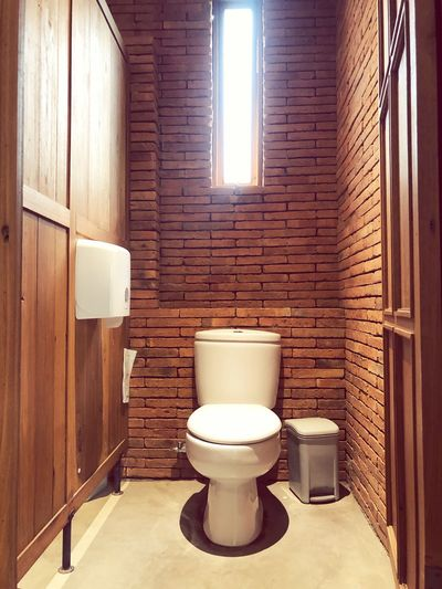 Toilet room on brick wall urban EyeEm Selects Indoors  Toilet Bowl Bathroom No People Toilet Domestic Bathroom Domestic Room Wall - Building Feature Home Interior Hygiene Seat Home Architecture Built Structure Brick Wall Window Wood - Material Wall Sunlight Day