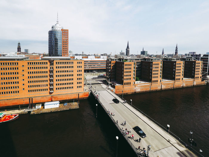 High angle view of bridge over river against buildings in city