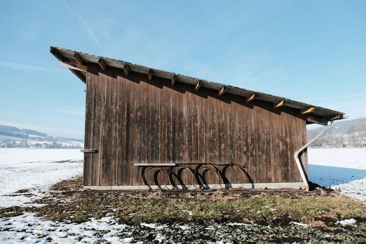 Wooden Structure On Field Against Sky During Winter
