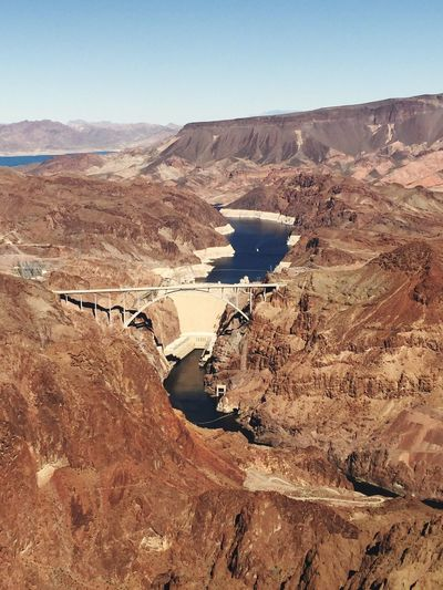 Above and beyond Hoover Dam Bypass Bridge Hoover Dam EyeEm Selects Nature Landscape Outdoors River Day Geology Scenics No People Clear Sky Travel Tranquil Scene Beauty In Nature Water Arid Climate Sky Travel Destinations Physical Geography The Traveler - 2018 EyeEm Awards