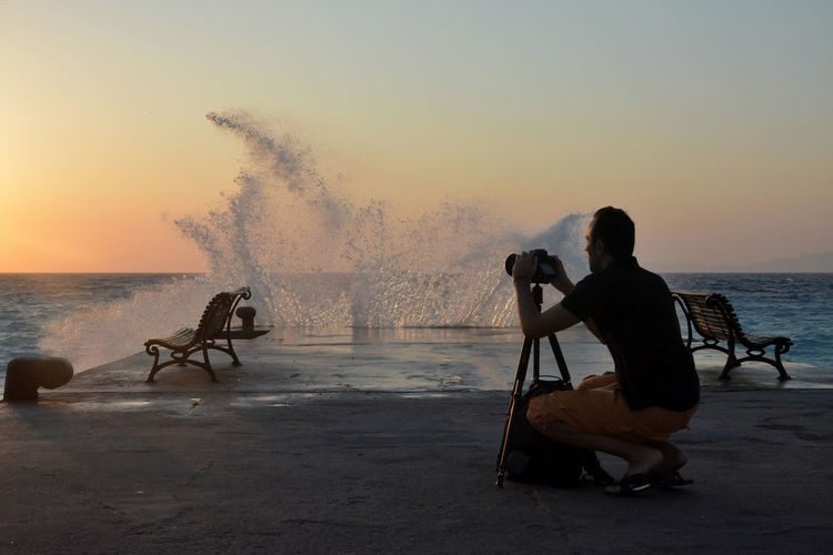 People Sea Motion Water Sunset Nature Real People Men Sky Sitting Outdoors Photographer Beauty In Nature Lifestyles Idyllic Horizon Over Water The Modern Professional Human Connection A New Perspective On Life My Best Photo