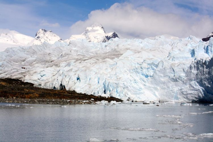 Remote tourists in an extreme route on glacial mountains