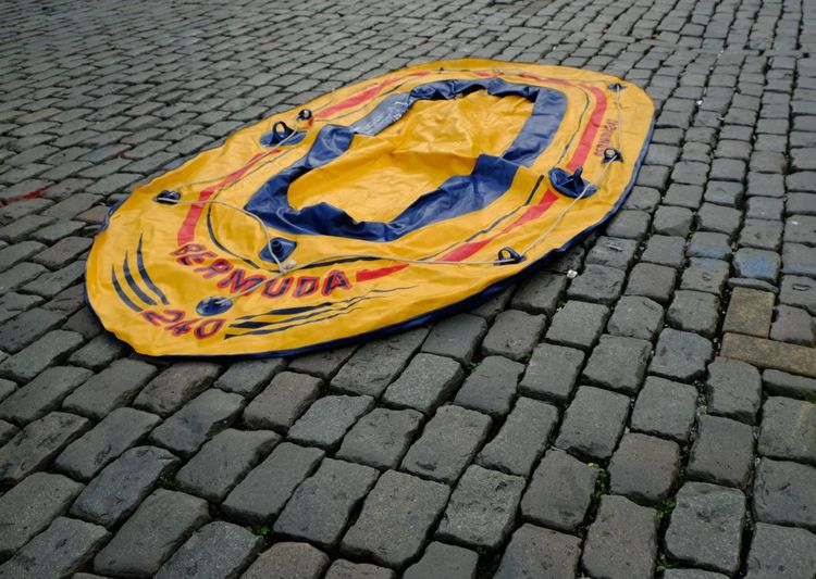 Cobblestone Streets Found Object Harbor Harbour Harbour View Holiday No Swimming Rubber Boat Swimming Traffic Boat Cobbled Streets Cobblestone Cobblestones Fleamarket Leisure Leisure Activity No Traffic Plastic Boat Street Street Traffic Rubber Dinghy Rubber Boot Rubber Raft Paint The Town Yellow
